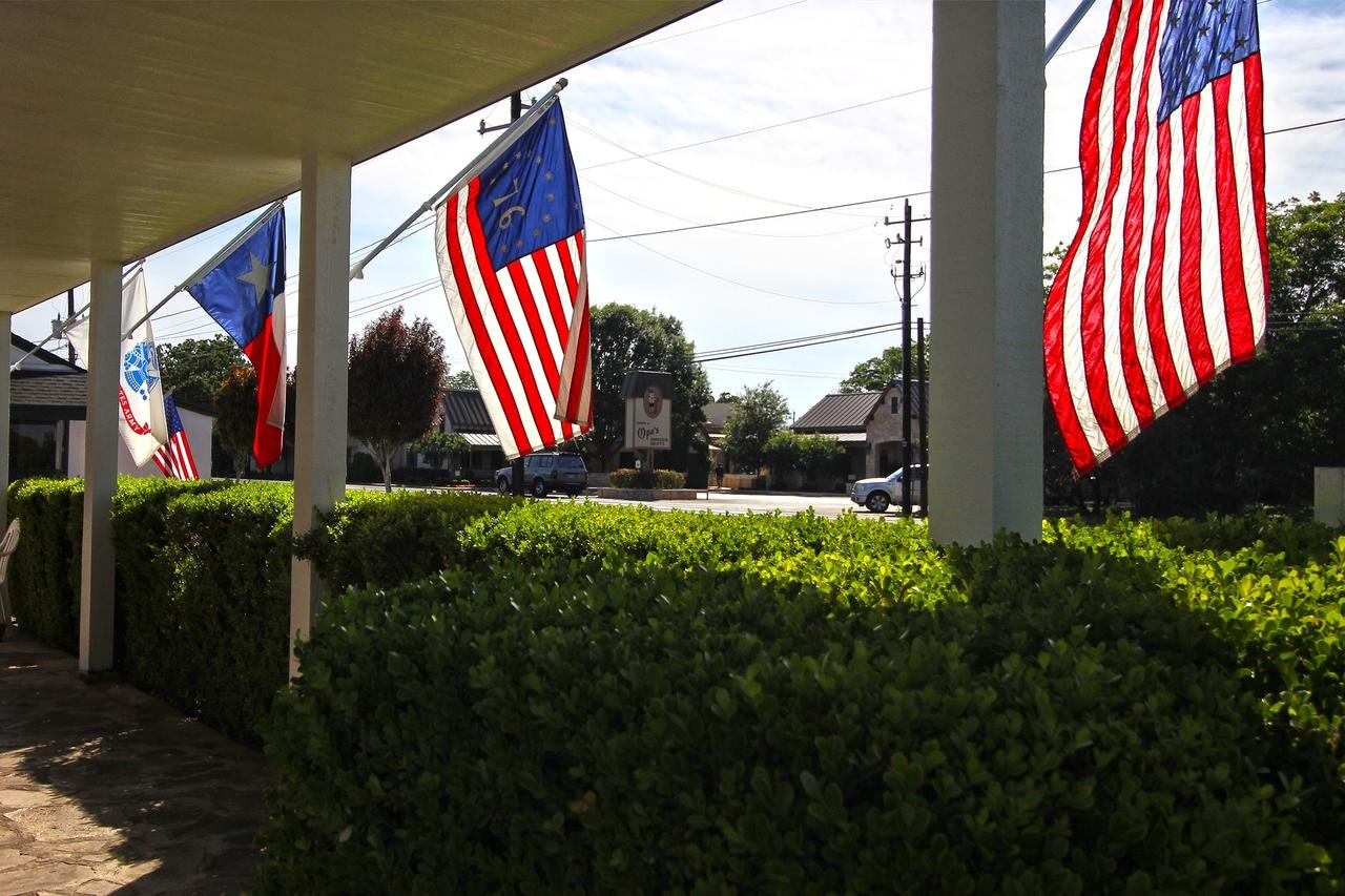 /var/www/html/wp-content/uploads/2018/11/Flags-from-beneath-the-porch
