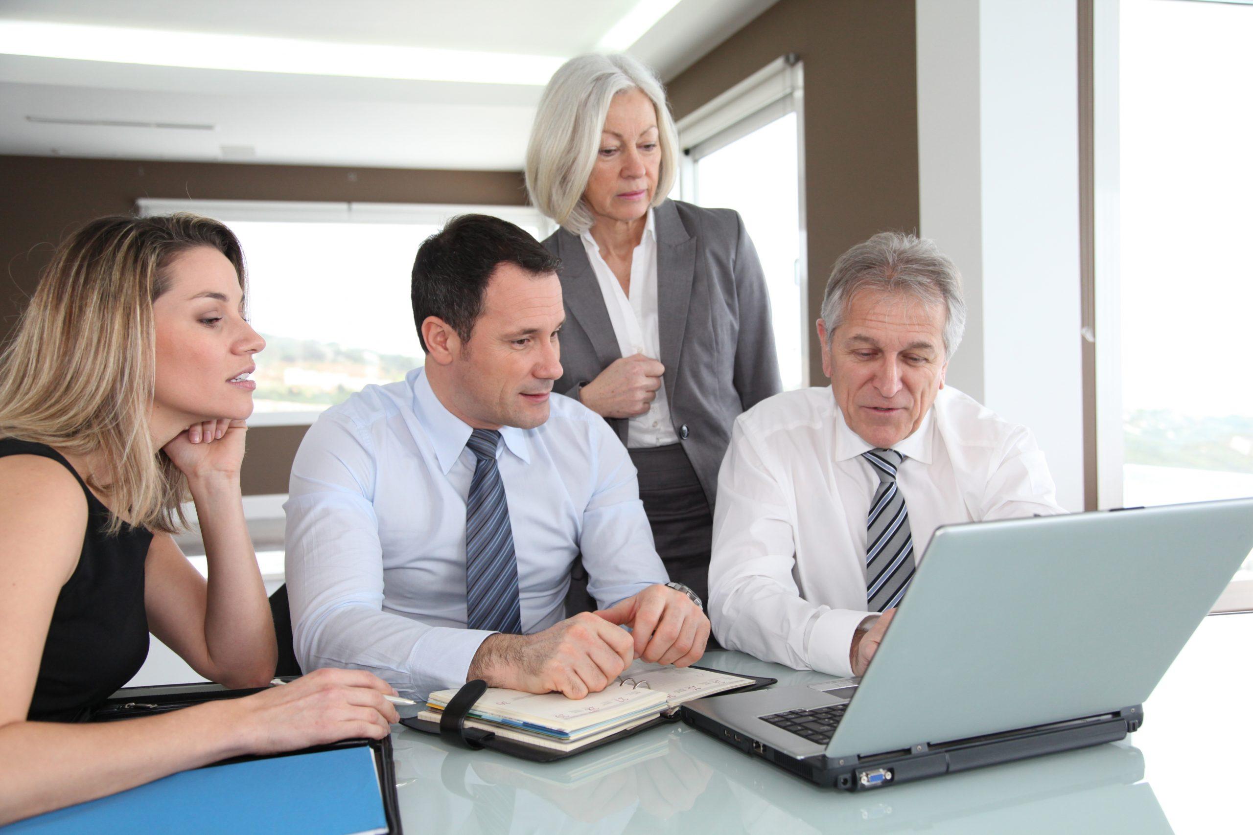 Sales people in work meeting