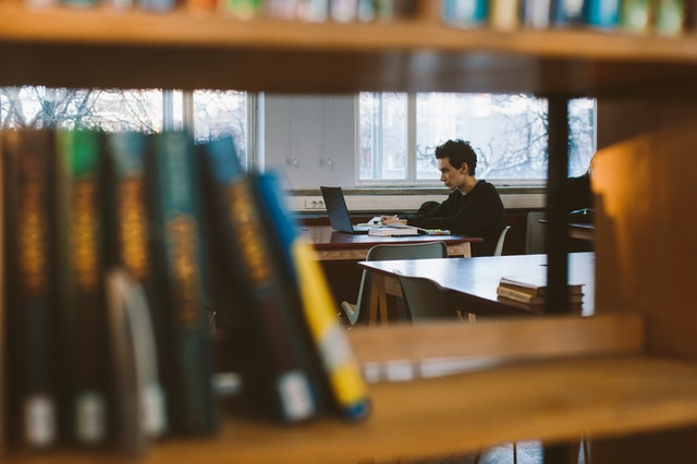 man-in-studying-in-library-3747548