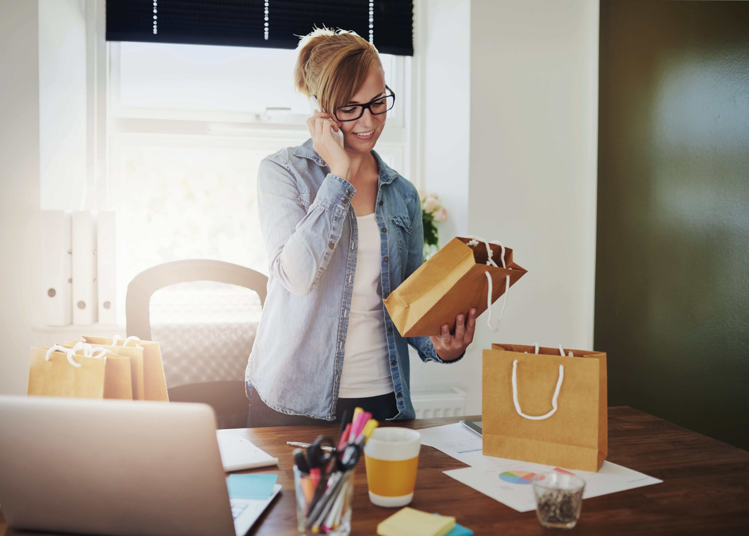 motivated-businesswoman-placing-orders-on-a-phone-PPXYWE7