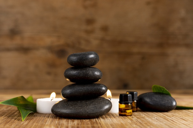 spa-arrangement-with-stones-candle_23-2148290942